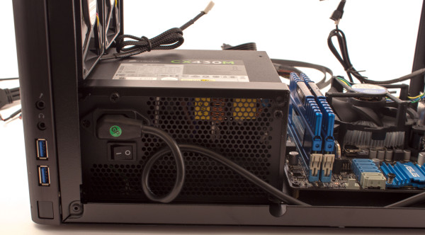 Power supply mounted in case.